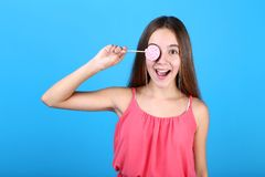 Young girl. With lollipop on blue background stock photo