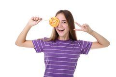 Girl with lollipop. Young girl with lollipop on white background stock photo