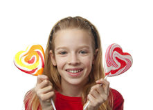Young girl with lollipops. Young blonde girl with lollipops over white background Stock Photo