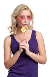 Young girl with lollypop Royalty Free Stock Images