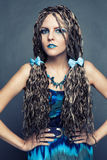 Young girl with long African braids in a blue dress royalty free stock photo