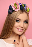 Young girl with long blond hair with elegant flower's headband Royalty Free Stock Images