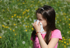 Young girl with long brown hair with allergy to the grasses blow Stock Images