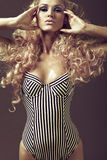 Young girl with long curly blond hair. Beautiful young girl with long curly blond hair Stock Photos
