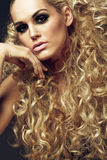 Young girl with long curly blond hair. Beautiful young girl with long curly blond hair Royalty Free Stock Image