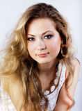 Young girl with a long fair hair Royalty Free Stock Photography