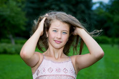 Young girl with long hair Stock Photos