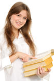 Young girl with long hair and book Royalty Free Stock Images