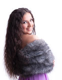Young girl with long hair in fur coat Stock Photo