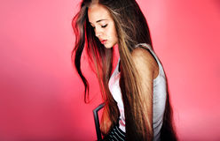 Young girl with long hair posing Royalty Free Stock Photography
