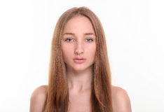 Young girl  on a white background. Young girl with long hair on a white background Royalty Free Stock Photos