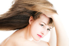 Young girl with long hair. On white background Stock Photo