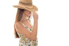A young girl with long hair is worth turning sideways to the camera with the hat on your head Stock Photography