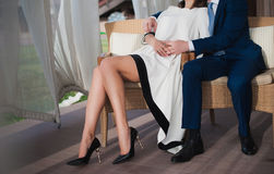 A young girl with long legs sitting and embraces the man Stock Photo