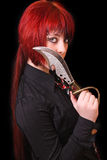 Young girl with long red hair and knife Royalty Free Stock Images