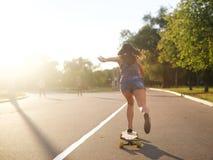 Young girl on longboard Stock Image