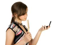 Young girl look in to mirror. And combing. Isolate on white Stock Images