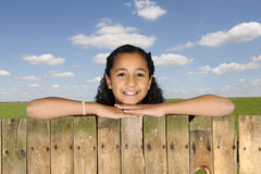 Young girl looking from above a fence Royalty Free Stock Image