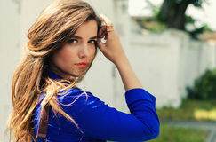 Free Young Girl Looking Back Over Her Shoulder Royalty Free Stock Photos - 74945218