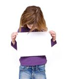 Young girl looking at blank sign. Portrait of a young girl looking at blank sign on isolated white background Royalty Free Stock Images