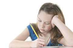 Young girl looking bored with work Stock Photo