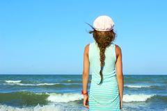 Young Girl Looking On A Calm Sea And Blue Skies, Back View. Stock Photography