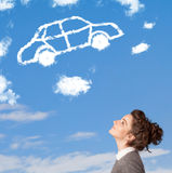 Young girl looking at car cloud on a blue sky Stock Photography
