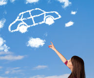 Young girl looking at car cloud on a blue sky Stock Image