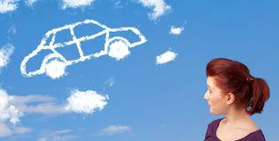 Young girl looking at car cloud on a blue sky Royalty Free Stock Image