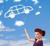 Young girl looking at car cloud on a blue sky. Casual young girl looking at car cloud on a blue sky stock photography