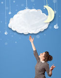 Young girl looking at cartoon night clouds with moon Stock Image