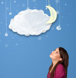 Young girl looking at cartoon night clouds with moon. Hanging down Stock Photography