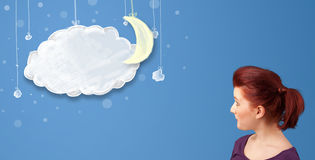 Young girl looking at cartoon night clouds with moon Royalty Free Stock Images