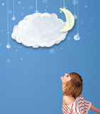 Young girl looking at cartoon night clouds with moon Royalty Free Stock Image
