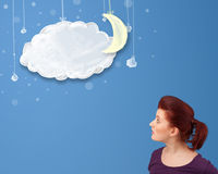 Young girl looking at cartoon night clouds with moon Royalty Free Stock Photography