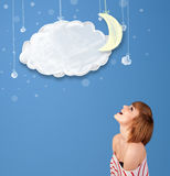 Young girl looking at cartoon night clouds with moon Stock Photos