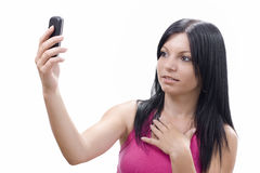 Young girl looking at the cell phone Royalty Free Stock Photography
