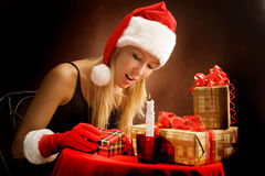Young Girl Looking at Christmas Presents Stock Images