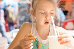 Young girl looking in disgust at her takeaway soda Royalty Free Stock Photo