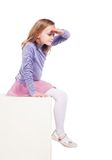 Young girl looking down a blank space Royalty Free Stock Photo