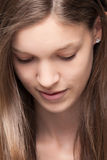 Young girl is looking down stock images