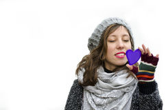 Young girl looking at a heart shaped mirror Royalty Free Stock Photography