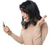 Young girl is looking on her phone. Isolated over white stock photos