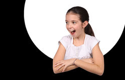 Young girl looking through a hole Stock Photos
