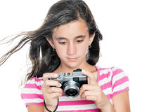 Young girl looking at images taken on a compact camera Stock Photos
