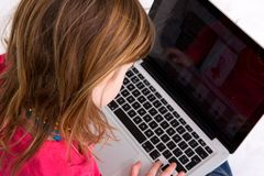 Young girl looking at laptop screen Royalty Free Stock Photography