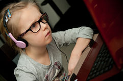 Young girl looking at laptop screen royalty free stock photo