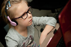 Young girl looking at laptop screen royalty free stock image