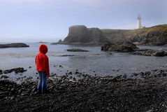 Young Girl Looking at Lighhouse Royalty Free Stock Image