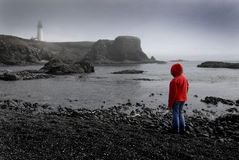 Young Girl Looking at Lighhouse Royalty Free Stock Photography